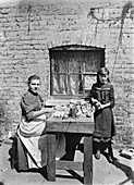 Assembling match boxes at home, 1900s