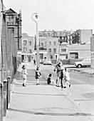 Children playing on Hopetown Street, London