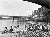 Cobbled causeway under Southwark Bridge, London, c1930