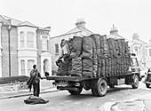 Charringtons delivering sacks of coal