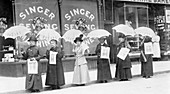 A parasol parade selling The Suffragette newspaper, 1914