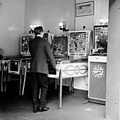 Man playing pinball in a London amusement arcade, c1966-67