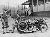 Golfers with a 1939 AJS and sidecar
