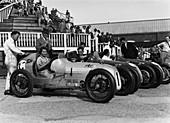 The Austin 7 team at Brooklands, Surrey, 1937