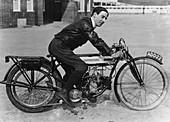 F Ball riding a 1913 Douglas motorbike