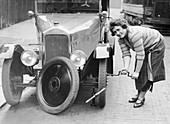 Ivy Cummings changing a tyre, London, c1925