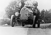 Boy in a pedal car