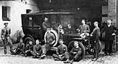Men with a 1911 Daimler, c1911