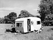 Couple on holiday with their 1963 Sprite Alpine caravan
