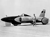 Craig Breedlove with Land Speed Record car, c1963