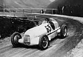 Rudolf Caracciola driving Mercedes-Benz W25 Grand Prix car