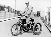 An 1898 De Dion tricycle and rider