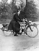 A woman on a Douglas motorbike, 1914