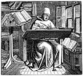 Monk at work on a manuscript in the corner of a scriptorium
