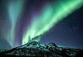 Aurora Borealis over mountain range