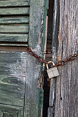 Padlock and chain on a door
