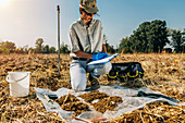 Soil scientist taking notes