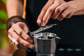 Making coffee with moka pot