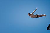 Man diving from 10 meter platform