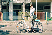 E-bike commuter on a business call