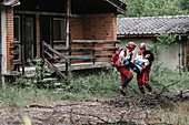 Rescue team evacuating woman from house