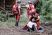 Paramedics rescuing woman
