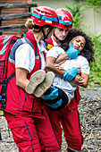 Rescue team evacuate woman from house