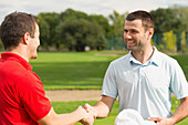 Golfers shake hands