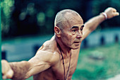 Fit senior man exercising in a park