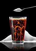 Glass of cola in front of pile of sugar, illustration
