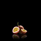 Fresh passionfruit whole and halved, illustration