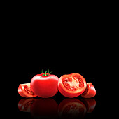Fresh tomatoes, whole, halved and slices, illustration