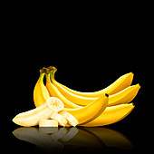 Bunch of bananas and slices of peeled banana, illustration