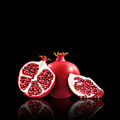 Whole and cut pomegranates, illustration