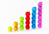 Bar graph made from columns of piggy banks, illustration