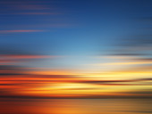 Blurred view of sunset over water, illustration