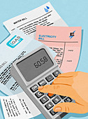 Man paying utility bills and using calculator, illustration
