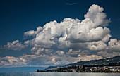 Cumulus mediocris clouds over a lake in Switzerland