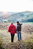 Couple visiting a land in the countryside