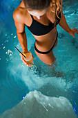 Woman enjoying hot tub in a spa