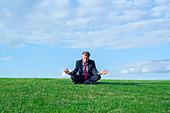 Businessman in lotus position