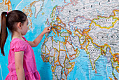 Girl looking at map of Europe