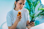 Woman using spirometer