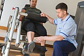 Hospital physiotherapist and patient