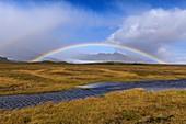 Rainbow over Icelandic glacier