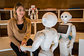 Researcher with Pepper and Nao robots