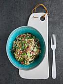 Carbonara with broad beans and salami