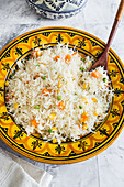 Mexican white rice cooked with peas, corn, carrots and chicken stock