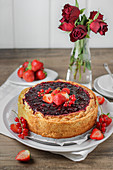 Pie with strawberries and redcurrants