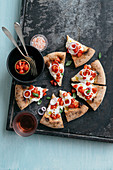 Pizza with cherry tomatoes, burrata and red onions